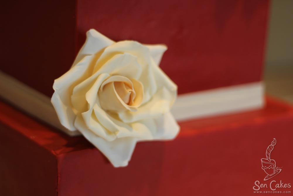 Red Square Wedding Cake With Cream Coloured Sugar Roses Cakestories Ca